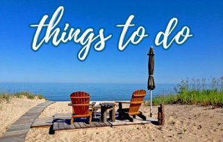 """Photo of beach chairs looking out over a lake stretching past the horizon with text overlay reading """"things to do - Michigan travel"""""""