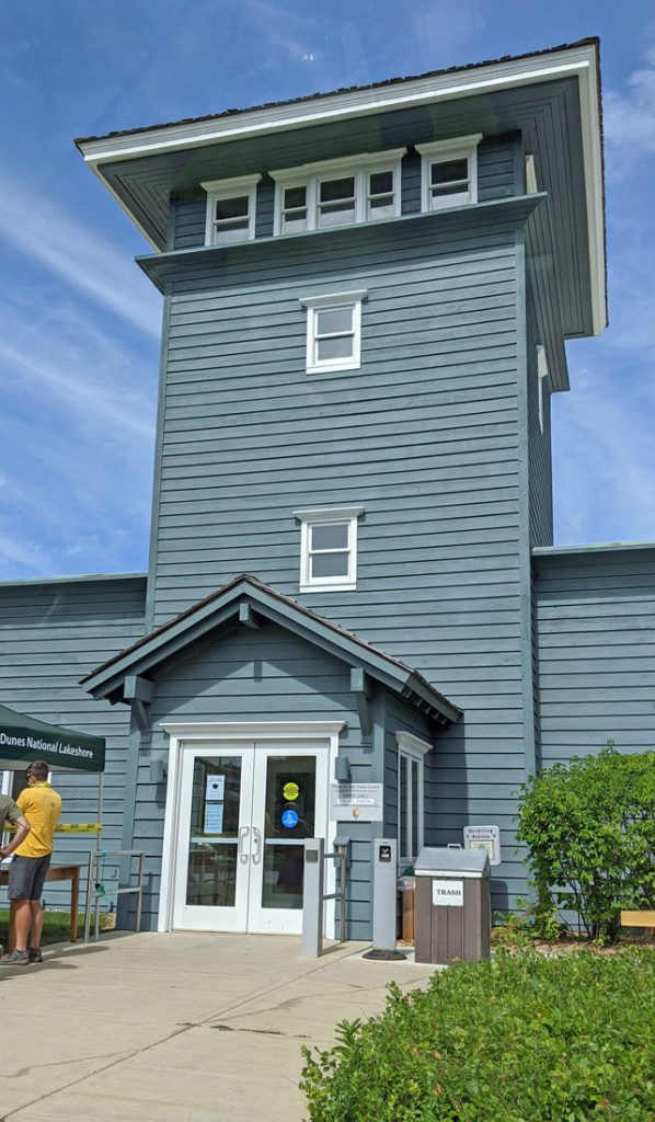 Grey sided building containing the Sleeping Bear Dunes visitor center