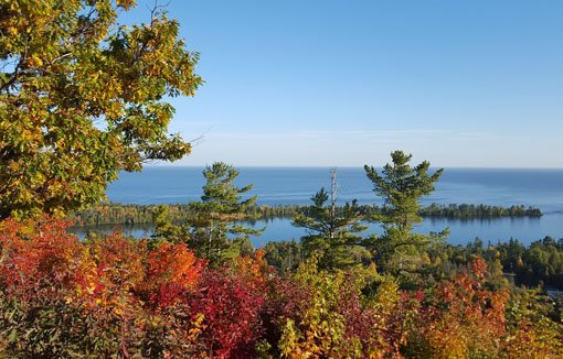 Colorful fall foliage with a large lake in the background