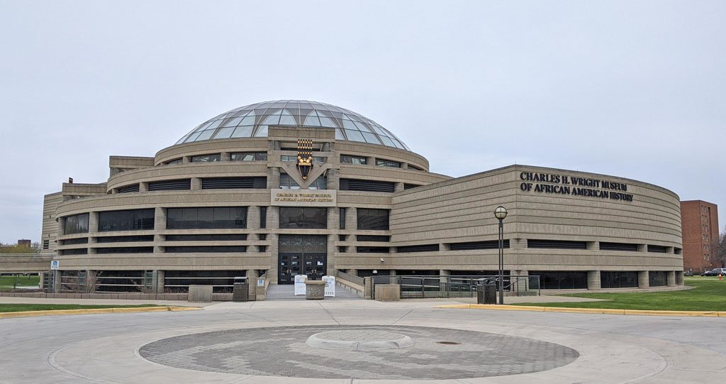 Large concrete building with a glass dome housing the Charles H. Wright Museum of African American History