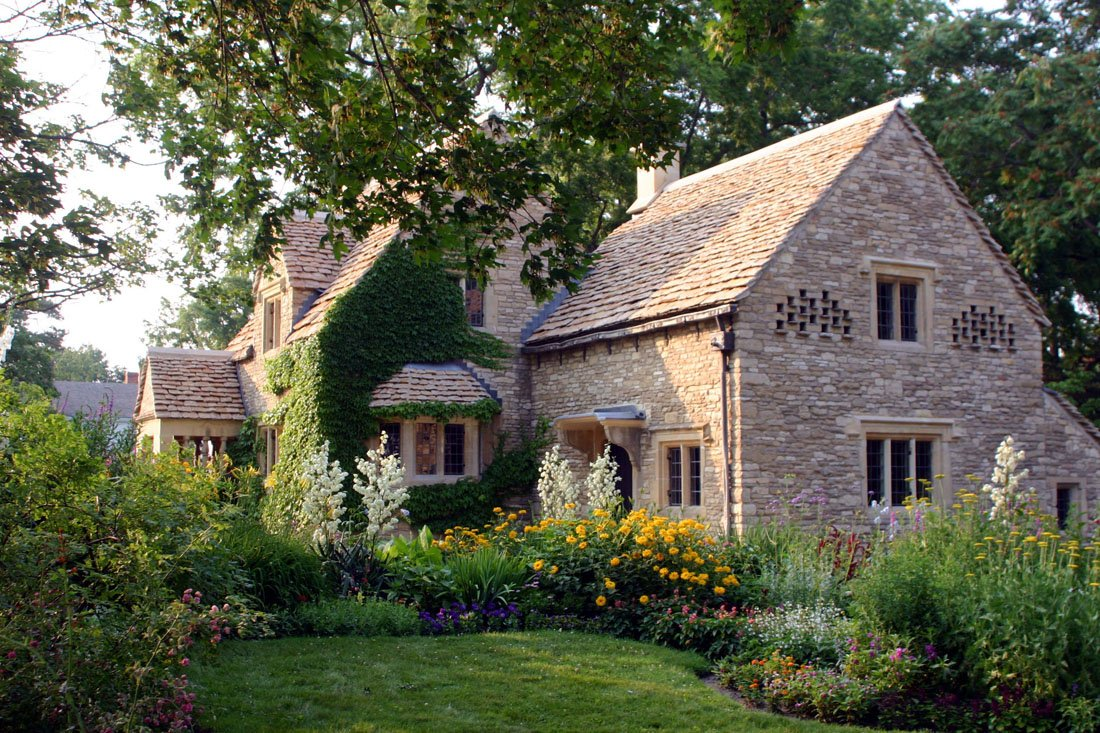 English style cottage surrounded by lush gardens