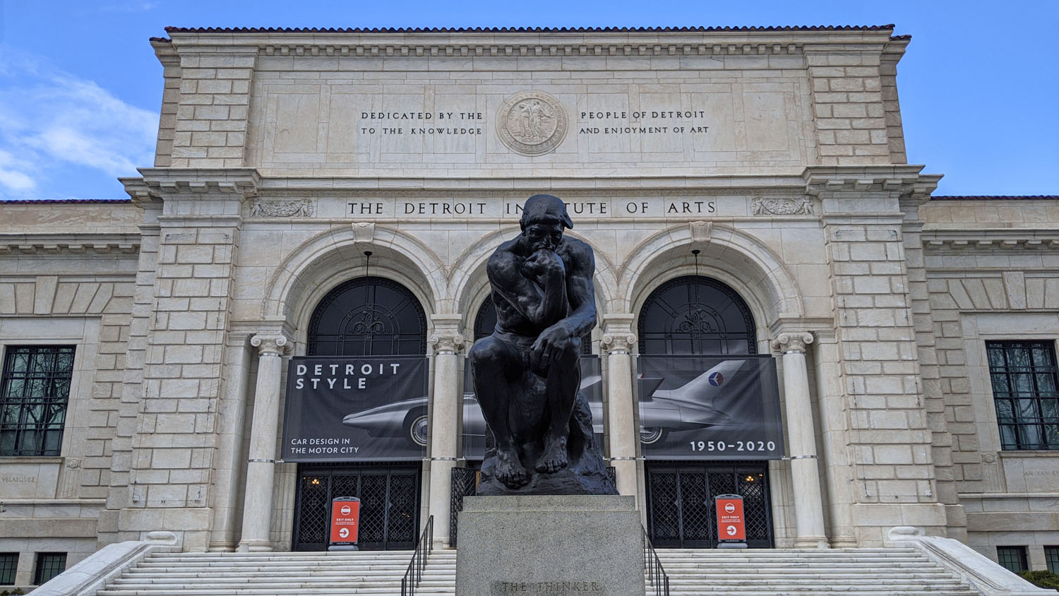 """Marble exterior of the Detroit Institute of Arts with a copy of """"The Thinker"""" in front"""