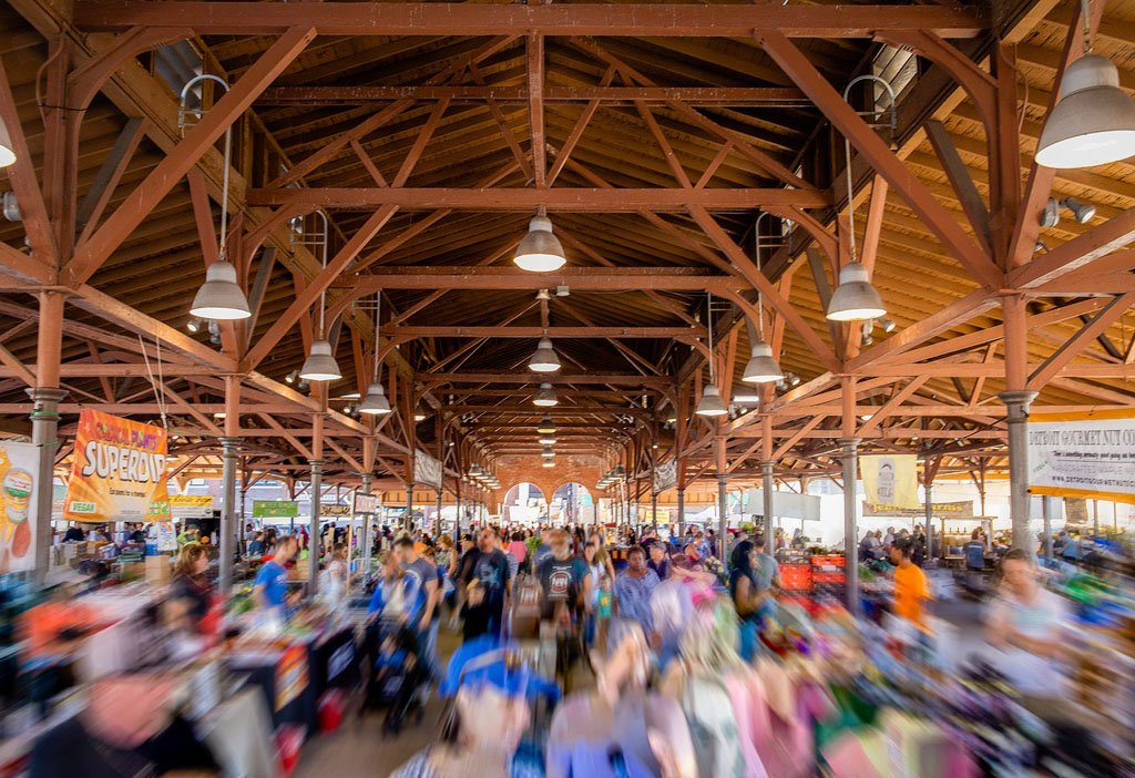 Motion blurred crowd of shoppers in one of Detroit's Eastern Market warehouses