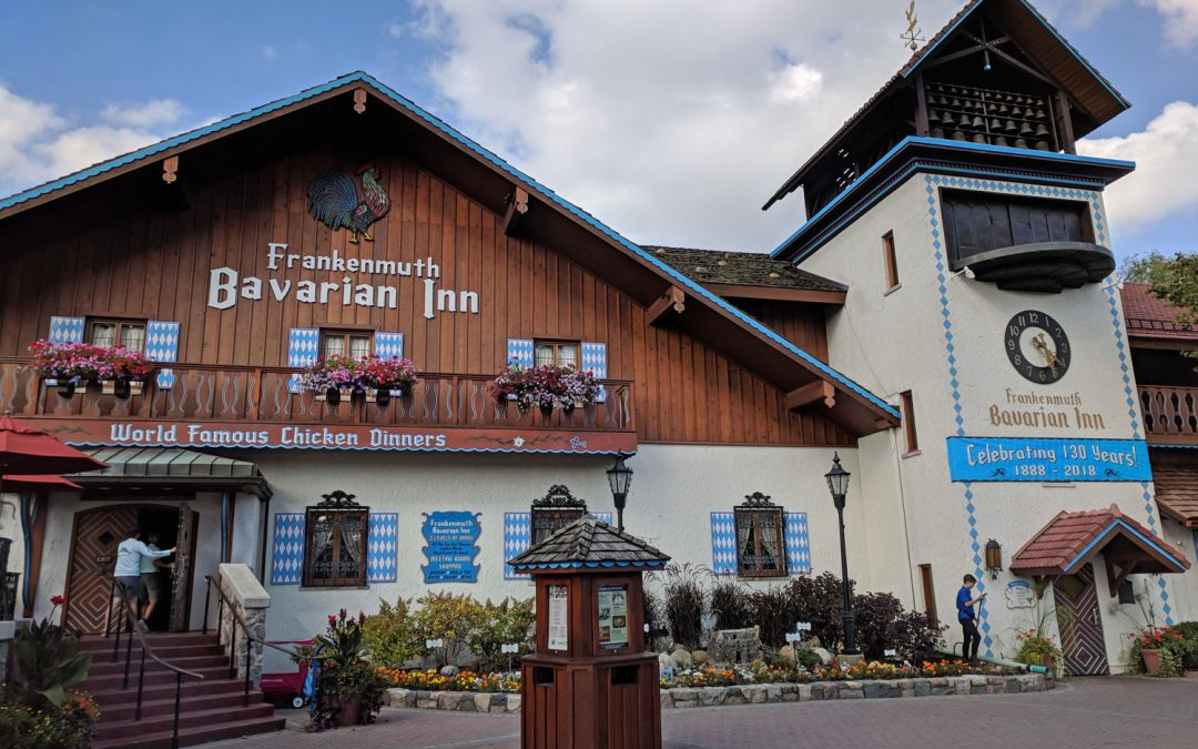 Photo of a Bavarian-style building with brown and blue trim labeled the Bavarian Inn Restaurant in Frankenmuth, Michigan