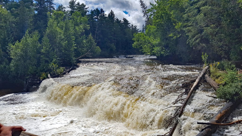 Lower Tahquamenon Falls, a series of cascades with water tumbling down low drops