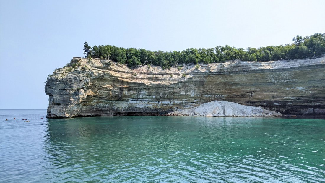 Cliffside with pile of rubble at the base in Pictured Rocks National Lakeshore