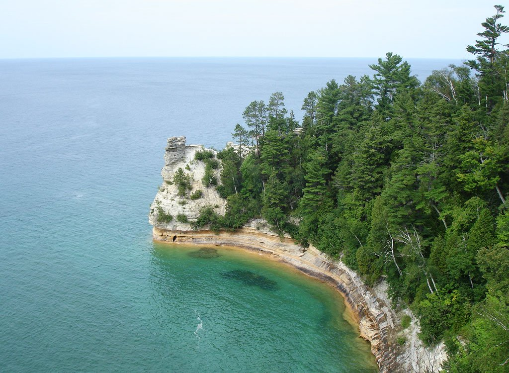 Miner's Castle, a rock formation rising from a cliff along the blue waters of Lake Superior