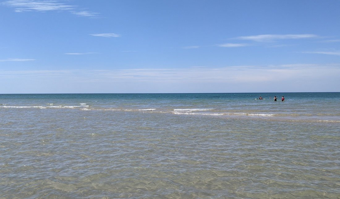 Small waves coming ashore in the turquoise waters of Lake Huron in Michigan's Sleeper State Park