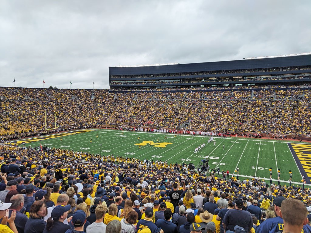 Michigan Stadium, full of spectators while teams take the field