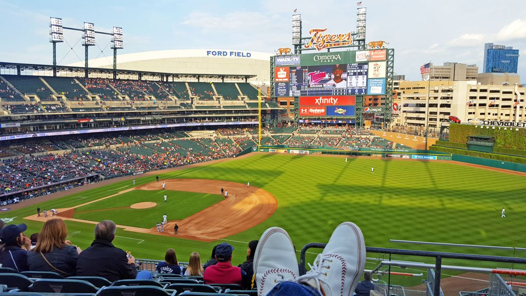 View of Comerica Park, a large baseball stadium with a towering scoreboard, from seats in the upper deck